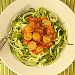 Sayguh's Spicy Olive Oil, Tomato and Lime Pasta Sauce Recipe - Chili flakes add heat to this tomato sauce spiked with lime juice.