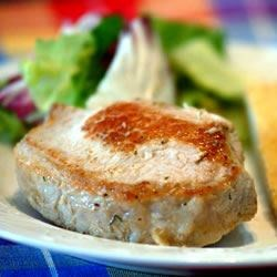 Stuffed Pork Chops III Recipe - Very easy recipe for tasty pork chops stuffed with bread crumbs, onion, parsley, spices and simmered in a beef broth.