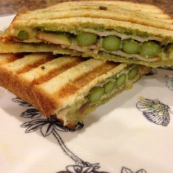 Grilled Turkey Asparagus Pesto Paninis Recipe - Grilled turkey and asparagus sandwiches with plenty of homemade pesto are quick to prepare and perfect for summer evenings.