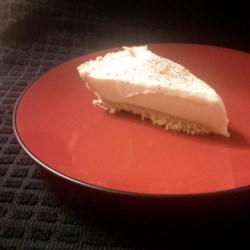 Eggnog Pie Recipe - Make the custard in the microwave, and let the pie chill overnight. Garnish with whipped cream and nutmeg, and dessert is done.
