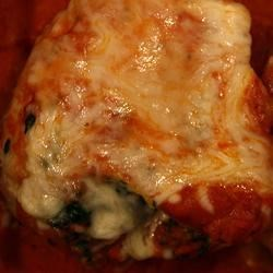 Florentine Stuffed Chicken Recipe - Bone-in chicken breasts stuffed with spinach, cheese and onion and baked until tender. This is a simple recipe that I cooked up myself. It is, however, based on some pretty standard Greek/Italian dishes. Everyone loves this and it can be wonderful for company - even people who don't usually like spinach find that they like this dish! Serve with your favorite shaped pasta, if desired.