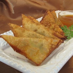 Cheeseburger Wontons Recipe - Cheeseburger wontons are just that: wonton wrappers filled with ground beef and cheese. Your whole family will love them!
