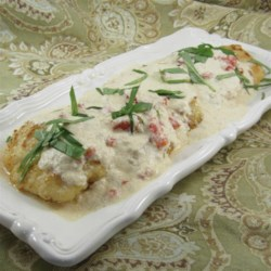 Chicken In Basil Cream Recipe and Video - Fried chicken gone to finishing school, as a basil-Parmesan sauce brings a mainstay dish to a new level.