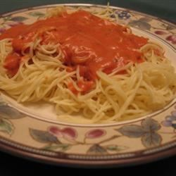 Pasta with Tomato Cream Sauce Recipe - Angel hair pasta is tossed with tomato sauce that's been gently simmered with half and half, garlic and spices.