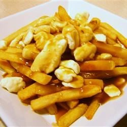 Real Poutine Recipe and Video - An indulgence of fries, gravy and cheese. A Canadian specialty!