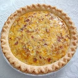 Country Quiche Recipe - A classic Quiche Lorraine with bacon, onions, eggs and cheese.