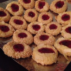 Thumbprint Cookies II Recipe - Small, delicious cookies with a small indentation filled with jam or preserves. Use your favorite nuts to coat the cookies.
