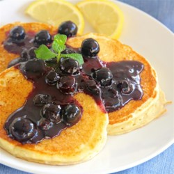 Lemon Ricotta Pancakes with Blueberry Sauce Recipe - Light, fluffy lemon ricotta pancakes are topped with blueberry sauce to create a delicious breakfast treat!