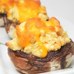 Buffalo Chicken Stuffed Mushrooms (Low-Carb) Recipe - Mushrooms stuffed with buffalo chicken dip are the perfect party appetizer for game day or dinner parties.