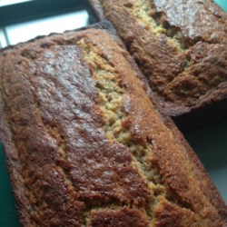 Honey Butter Zucchini Bread Recipe - Moist, sweet, zucchini bread is rich with honey, butter, walnuts and coconut.