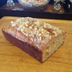 Best Hawaiian Banana Nut Bread Recipe - Shredded coconut, macadamia nuts, and pineapple give this banana bread a Hawaiian twist. It is perfect for brunches or alongside a cup of coffee.