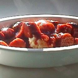Deviled Sausages Recipe - Sausages bathed in a sweet and spicy sauce of soy, Worcestershire, cayenne, mustard, tomato paste, and brown sugar. Use beef or pork sausages. Serve with potatoes, a sweet potato mash, or on a bed of steamed rice with vegetables.