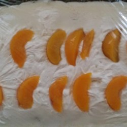 Peach Filled Cake Recipe - This is a lovely cake to make when peaches are ripe.  It is a lemon cake filled with fresh peach slices.