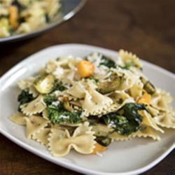 Farfalle with Roasted Winter Vegetables & Parmigiano-Reggiano Cheese Recipe - Roasted squash and Brussels sprouts with sauteed chopped kale are tossed with cooked farfalle pasta and lots of grated cheese for a hearty, cool-weather meal.