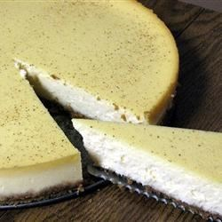 Kim's Eggnog Cheesecake Recipe - This is a wonderful cheesecake. The eggnog doesn't overpower the cheesecake and the cheesecake doesn't overpower the eggnog. The result is sinfully smooth and delicious!