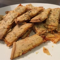 Pizza Fries Recipe - Pie crust is topped with marinara and mozzarella cheese, cut into strips, and baked into pizza fries creating a fun snack for the whole family.
