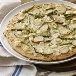 Asparagus, Potato and PHILLY Pizzeria Pizza Recipe - This is not your usual pizza, but it is unusually appetizing. Garlic oil, asparagus, and potato slices, along with cream cheese and mozzarella top Perfect Parmesan Pizza Crust.