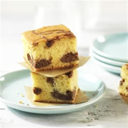 Chocolate Cheesecake Blondies Recipe - This dessert could not be simpler and the result more delicious. A perfect marbled swirl of creamy chocolate cheesecake in a moist cake - a sure, easy winner of a recipe.