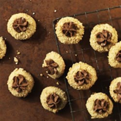 Chocolate-Hazelnut Thumbprints Recipe - What's better than freshly baked homemade cookies? These cute little cookies, featuring the classic combo of hazelnuts and chocolate, are sure to become a new family favourite.