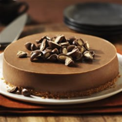 Chocolate-Almond Cheesecake Recipe - Delicious cookie base, creamy chocolate cheesecake, crunchy chocolate-covered almonds - what a combo! This recipe is a perfect blend of sweet and creamy - a great cheesecake to try!