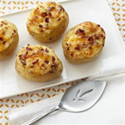 Make-Ahead All-Dressed Baked Potatoes Recipe - Stuffed potatoes are prepared ahead of time with Cheddar, cream cheese, and bacon bits, then heated in an outdoor barbecue.
