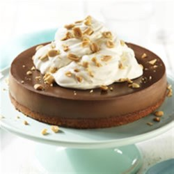 Peanut Butter-Chocolate Cheesecake Recipe - The classic combo of chocolate and peanut butter go together perfectly in this creamy cheesecake. What could be better?