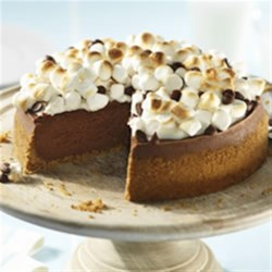 PHILLY S'more Cheesecake Recipe - Bring a little of the campfire indoors any time of the year with this stunning dessert. The creamy chocolate cheesecake, graham crust and toasted marshmallows all team up to make a truly delectable dessert!