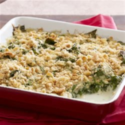 Saucy Spinach Bake Recipe - Need a fresh idea for spinach? This side dish combines spinach in a cheesy sauce with a topping of crushed crackers and shredded Mozza-Cheddar cheese.