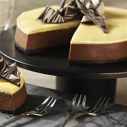 Tuxedo Cheesecake Recipe - Chocolate and vanilla come together as a perfect pairing in this gorgeous layered cheesecake - the perfect dessert for impressing a crowd.