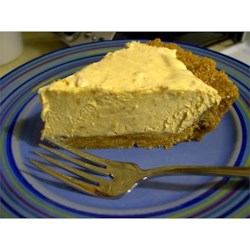 Peanut Butter Pie 2000 Recipe - Peanut butter is combined with whipped cream cheese and sugar, and then milk is poured in slowly and beaten until well blended. Whipped topping and chopped peanuts are folded in, and then this yummy filling is spooned into a graham cracker crust and frozen.