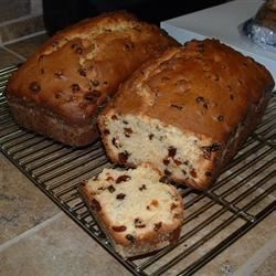 Eggnog Fruit Bread Recipe - Eggnog is the star in this holiday quick bread that combines pecans, raisins, and red and green candied cherries.