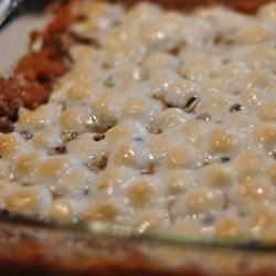 Mashed Sweet Potatoes Recipe - Sweet potatoes mashed with orange juice, butter and sugar, topped with marshmallows, and placed under the broiler for a sweet, golden crust.