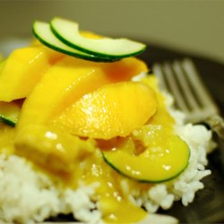 Spicy Indian Chicken and Mango Curry Recipe and Video - This delicious, Indian-inspired dish is made by quickly cooking chicken and shallots with curry paste, then bathing everything with a coconut milk-mango puree!