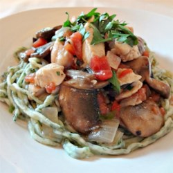 Not Really Chicken Scampi Recipe - Chicken breasts and portobello mushrooms are tossed with linguine, tomatoes, and a squeeze of lemon for a quick weeknight meal.