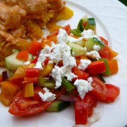 Sylvia's Easy Greek Salad Recipe - This is a classic, but easy Greek salad with a simple, simple dressing. Chop and dice all the veggies  - bell peppers, cucumbers, tomatoes, red onions, and olives. Then whip up the vinegar and oil dressing. Toss one with the other, and add crumbled feta cheese.