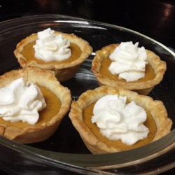 Mini Pumpkin Pies Recipe - Mini Pumpkin Pies are perfect when you want to have several desserts and make sure everyone can try them all!