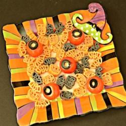 Eyeballs for Halloween Spaghetti Recipe - Use cherry tomatoes, mini balls of mozzarella cheese, slices of black olives, and careful knife skills to make delightfully fun eyeballs to serve on your pasta.