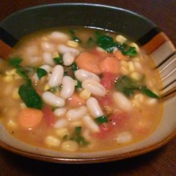 White Bean Soup Recipe - A delicious white bean and corn soup, seasoned with garlic, savory, and thyme. Tastes even better the next day, and can easily be made vegetarian!