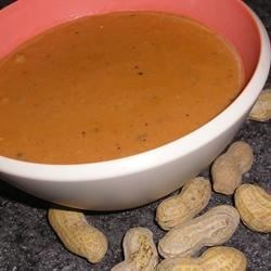 West African Peanut Soup Recipe - A delightful flavor combination of peanut butter and tomatoes make this soup an unconventional favorite. Freezes and reheats well to be enjoyed all year long!
