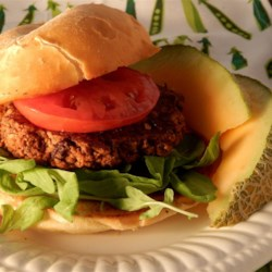 Black Bean and Walnut Burgers Recipe - Hearty and nutty, these black bean burgers are made with cooked sweet potato, walnuts, Fresno chile pepper, rolled oats, and flaxseed.