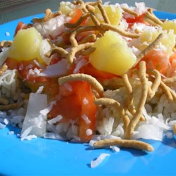 Happy Mountain Recipe - Rice is topped with chicken in a cream sauce, then garnished with cheese, tomato, onion, pineapple and coconut. This melody of flavors mixed together sounds weird but the combination put together brings delicious results!!! This recipe was given to me by my aunt 20 years ago and I've been making it for my family ever since.