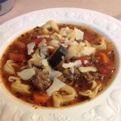 Italian Sausage Soup with Tortellini Recipe and Video - Italian sausage, garlic, tomatoes, red wine, and tortellini - this soup combines favorite ingredients from an Italian kitchen.  You can use sweet or hot sausage, depending on your tastes, and fresh herbs if you have them on hand.