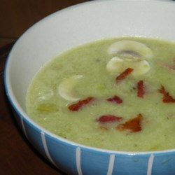 Cream of Asparagus and Mushroom Soup Recipe - The savory flavors of mushrooms and bacon make this cream of asparagus soup a warm starter course for a meal.