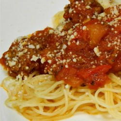 Jeanne's Slow Cooker Spaghetti Sauce Recipe - Turkey kielbasa, ground beef and ground turkey are slow cooked with tomatoes and a host of veggies including yellow squash and green bell pepper. You can also prepare this sauce on the stove top, simmering it for several hours.