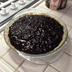 Huckleberry Cream Cheese Pie Recipe - A pecan pastry is the base of this cream cheese pie that's topped with a delicious huckleberry sauce.