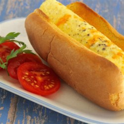 The Legendary Egg Dog Recipe - The 'legendary egg dog' involves placing a cooked egg in a hot dog bun and topping it with hot sauce for a quick and easy breakfast.