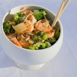Shrimp Stir Fry With Egg Noodles Recipe - Broccoli, red bell pepper, water chestnuts, baby corn, and bamboo shoots are stir-fried with cooked shrimp and served over a bed of fresh egg noodles.