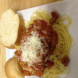 Ground Sausage Spaghetti Recipe - Quick and easy, this spaghetti with ground sausage and extra cheese is a great go-to recipe on a busy night.