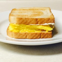 Tom's Scrambled Egg Sandwich Recipe - Sandwich scrambled eggs between two slices of toast with a little mustard and mayo in this recipe that's been handed down through the generations.