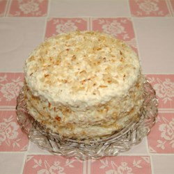 Rave Reviews Coconut Cake Recipe - A wonderful moist coconut cake perfect for birthday parties. Walnuts and pecans are interchangeable in this recipe.